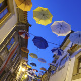 Umbrellas against evening sky, Portugal