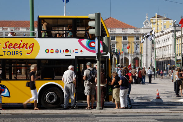 Tourists with yellow bus