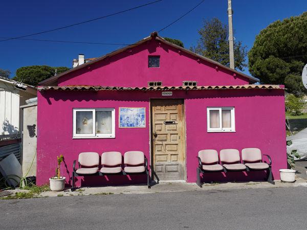 Mauve house with seats