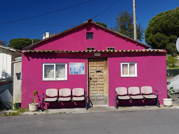 Mauve house with chairs