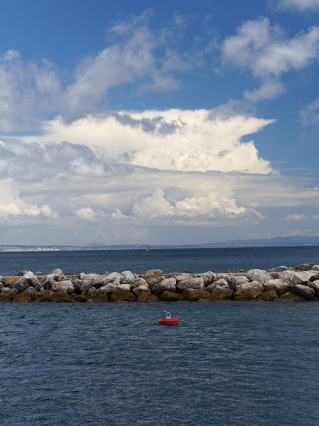 Breakwater with clouds