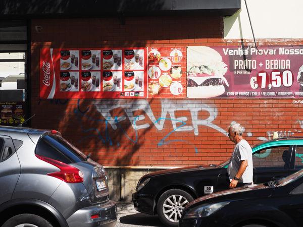 Man with graffiti wall
