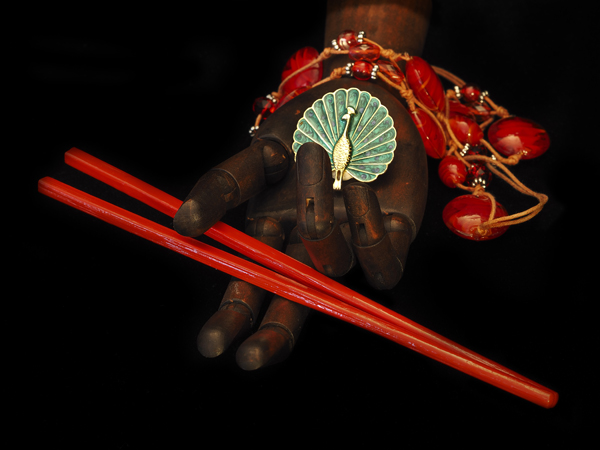 Red chopsticks with green peacock