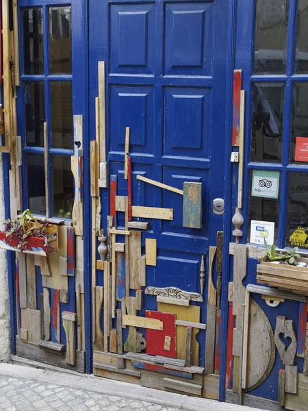 Blue door with pieces