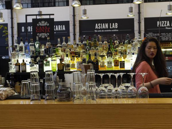 Bar girl with bottles