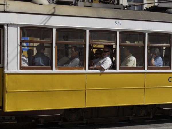 Yellow tram with passengers