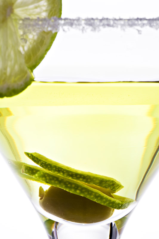 Green olive and lemon in frosted glass