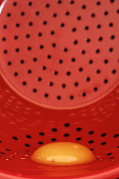 Egg yolk in red colander