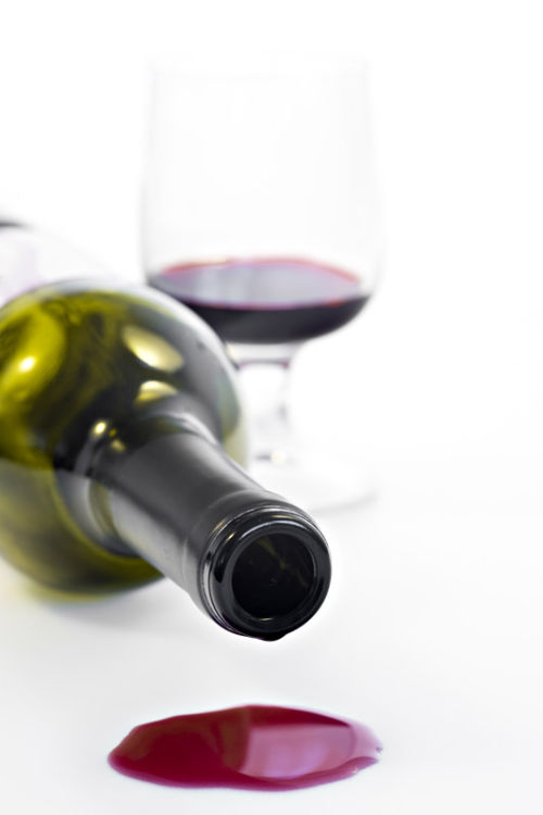 Bottle with spilled wine
