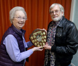 "Peggy presents the Foursome Trophy to Malcolm Imhoff for winning the Audience Vote with M&M's  ""Love Will Remain"""