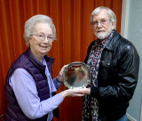 "Peggy presents the Maggie Imhoff Trophy to Malcolm for ""Love Will Remain"""