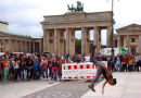 Street Performer in front of the Brandenburg Gate.