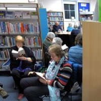 Enjoying a good book at the Oundle Library sit-in