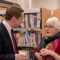 Tom Pursglove Mp chatting to a library user