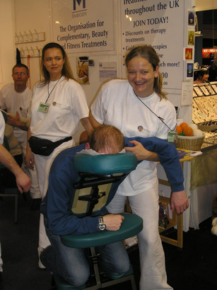 Me giving on-site shiatsu at the Ideal Home Show