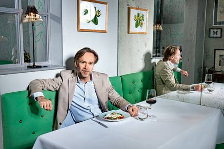 Marcus Wareing sitting below Medlar painting at Medlar Restaurant