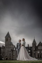 Fort Augustus Wedding Photography. Inverness Wedding Photography. Loch Ness Wedding Photography Dark and moody on a rainy day.Bride & Groom in romantic pose outside an old abbey.