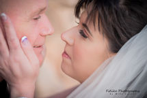 Bride and groom in romantic pose looking into each others eyes.
