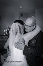 Bride and Dad embrace.