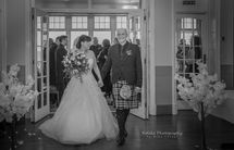 Bride and Groom walk down the aisle at Cullen Bay Hotel.