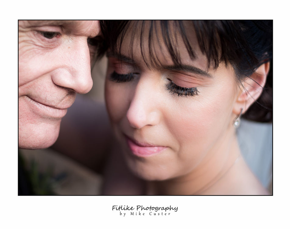 Bride & Groom holding in a romantic pose. Natural light.