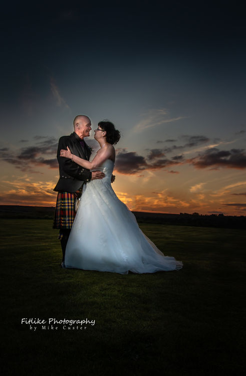 Sunset photograph of the bride and groom.
