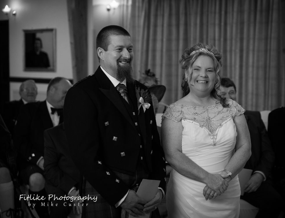 Wedding photographs of the bride and groom standing at the altar. By Aberdeenshire wedding photographer Fitlike Photography.