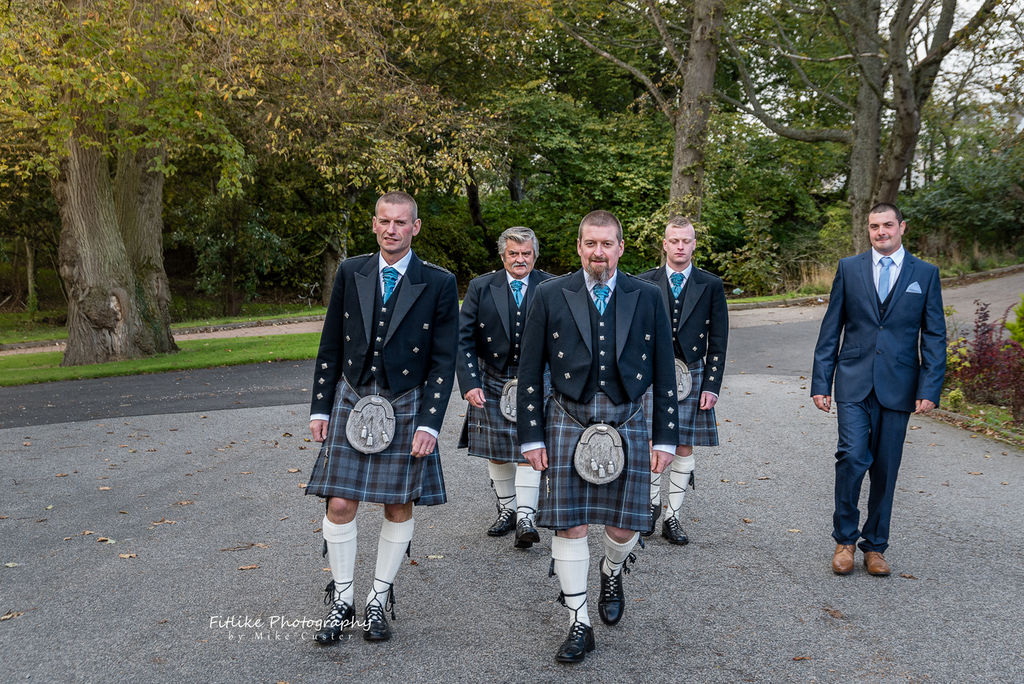 Wedding photograph of the groom and groomsmen walking towards the camera in natural light. Taken by Aberdeenshire Wedding Photographer Fitlike Photography