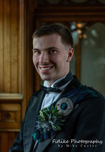 Groom posed in natural light at the chapel.