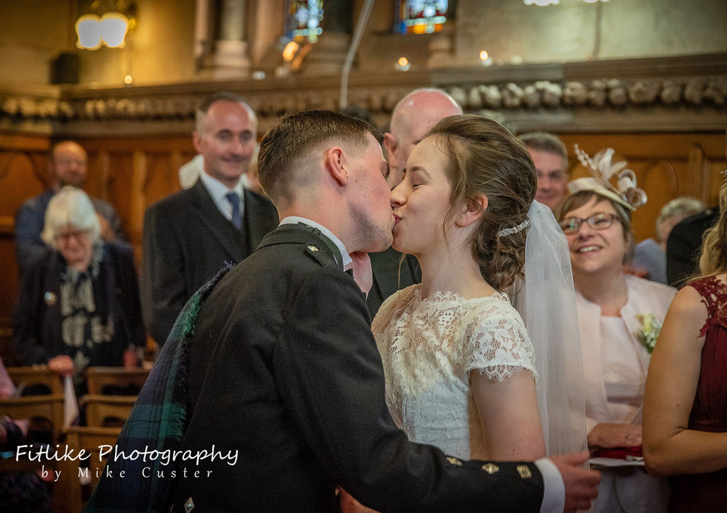 Bride and Groom first kiss. RNI Chapel, Inverness.