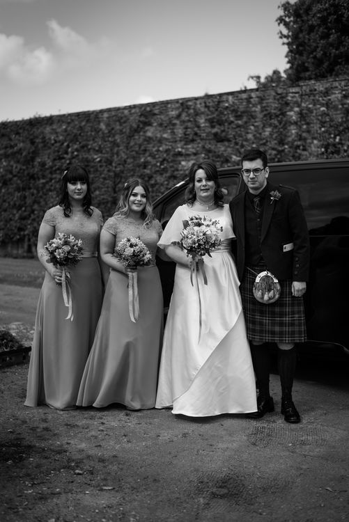 The bride with her bridesmaids (also her daughters) and son just before the wedding ceremony