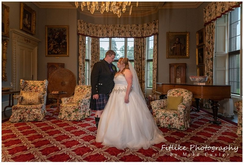 The Bride and Groom posed in the Drawing room at Brodie Castle, Forres, Moray.
