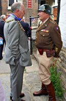 'General ' Patton talks tactics with the Mayor