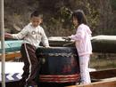 Chinese children playing drum on Dragonboat.0185DHK