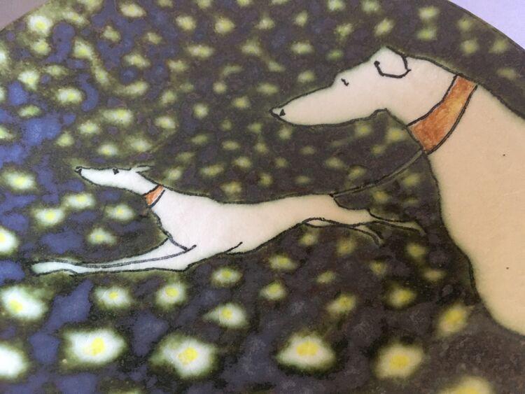 Longdogs in daisies III