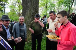 Village people eating and drinking after mass, Maramures, Romania