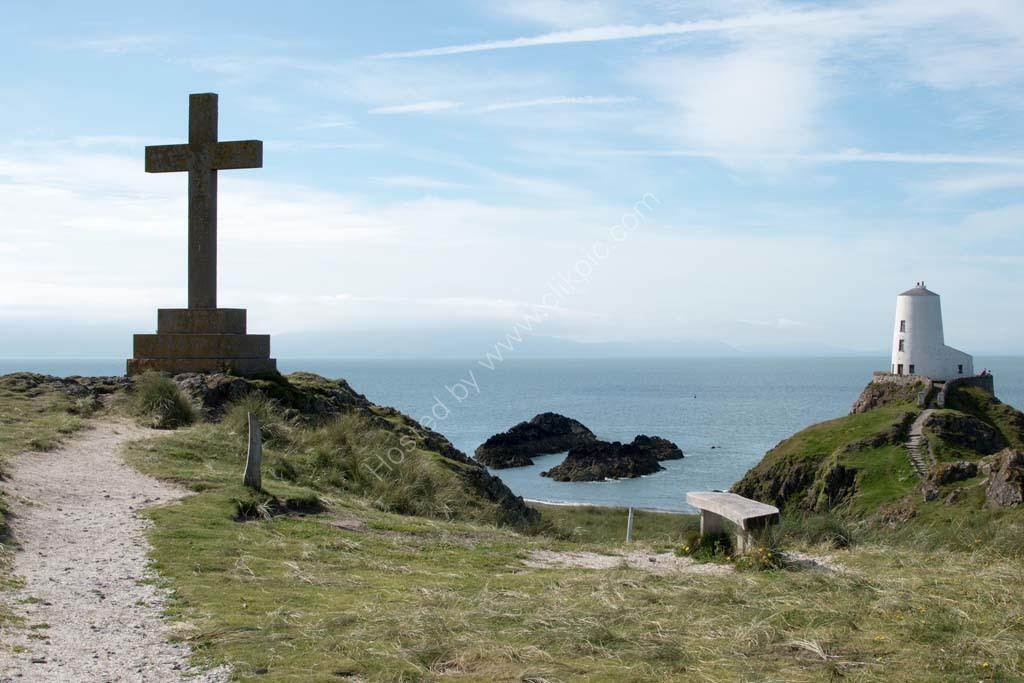 Cross and Lighthouse Llanddwyn Island Anglesey