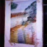 Water is brushed on to dissolve the pastel and eliminate the white of the paper