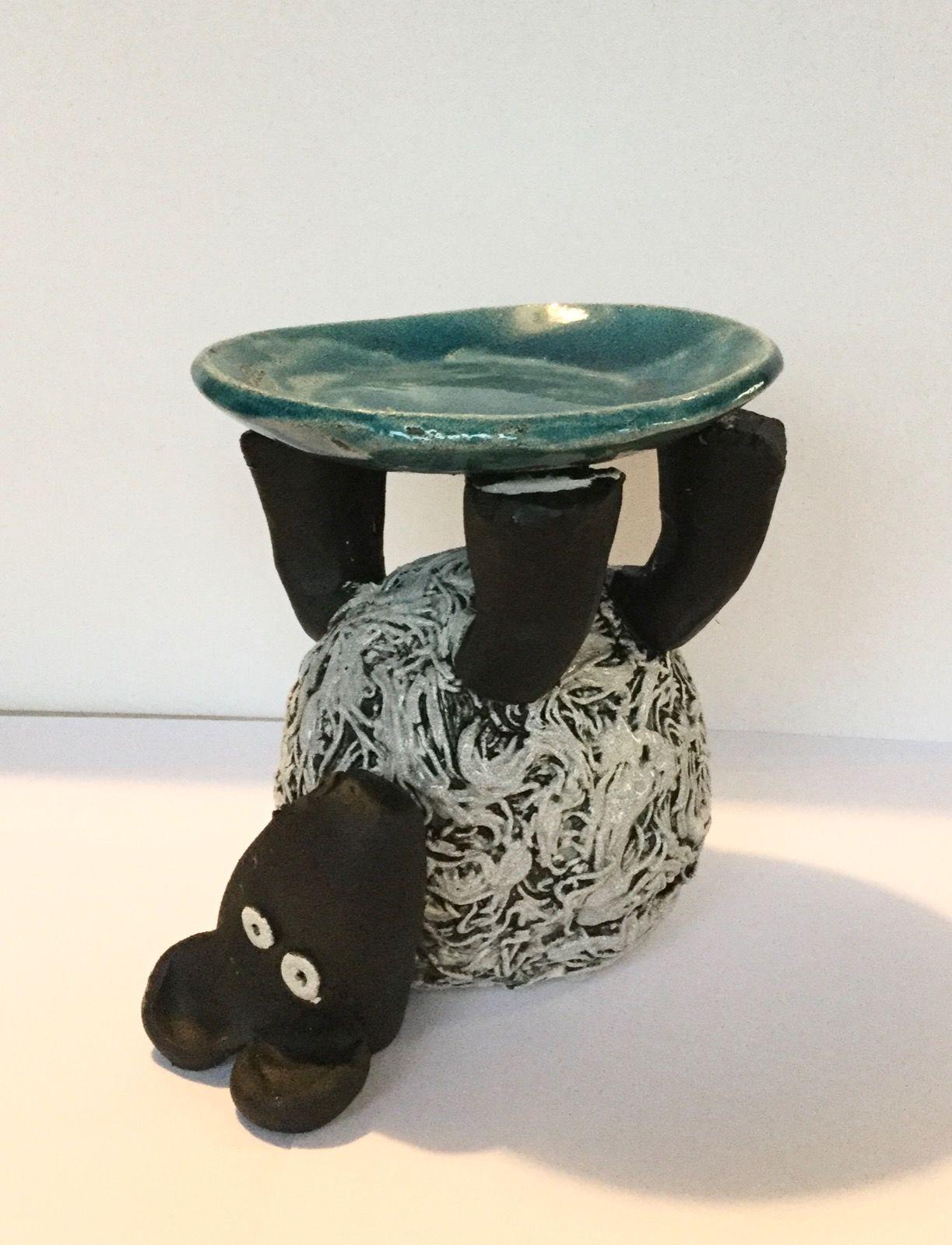 Sheep balancing bowl