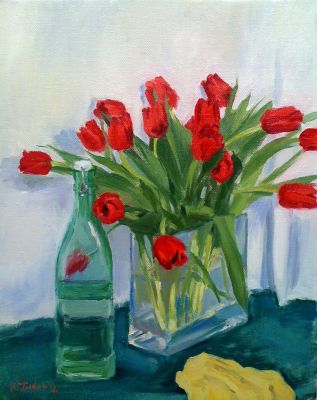 Still life of red tulips with green bottle