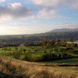 SCOTLAND - Prestonfield Golf Course from Arthur's Seat, Edinburgh with the Pentland Hills in the distance