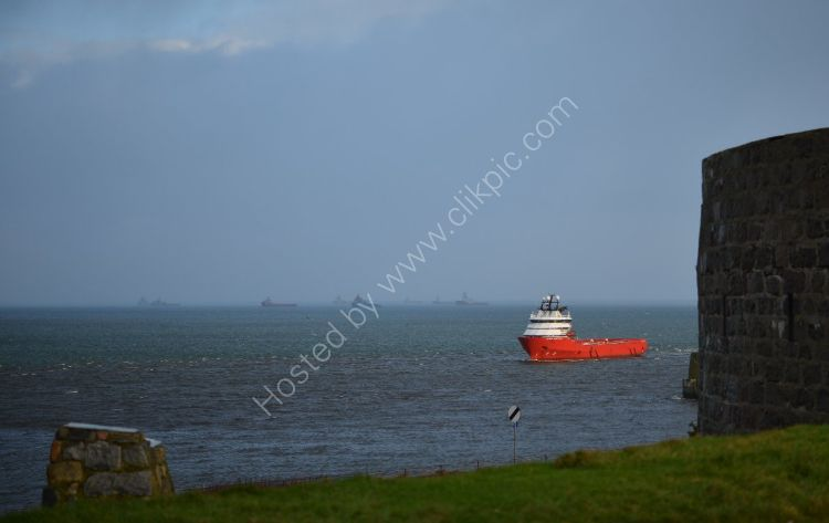 SCOTLAND - Supply Vessel heads for port past the Torry Battery at Aberdeen