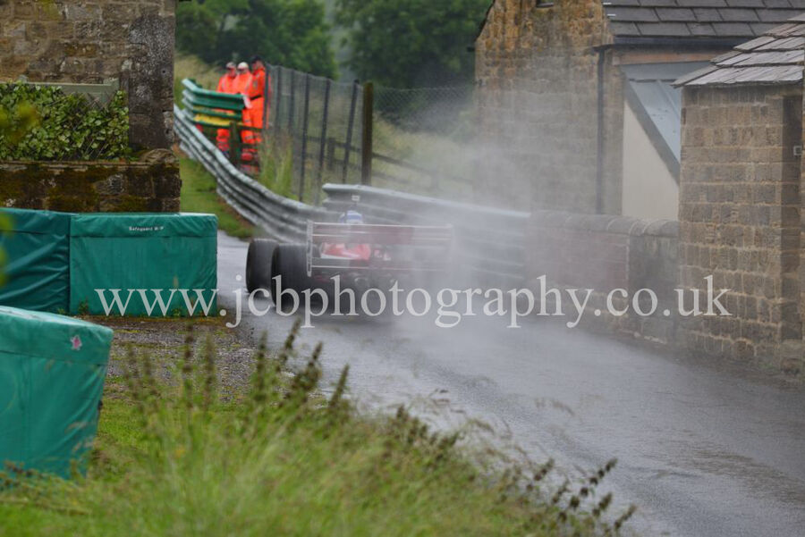 Single Seater goes though Farm House buildings