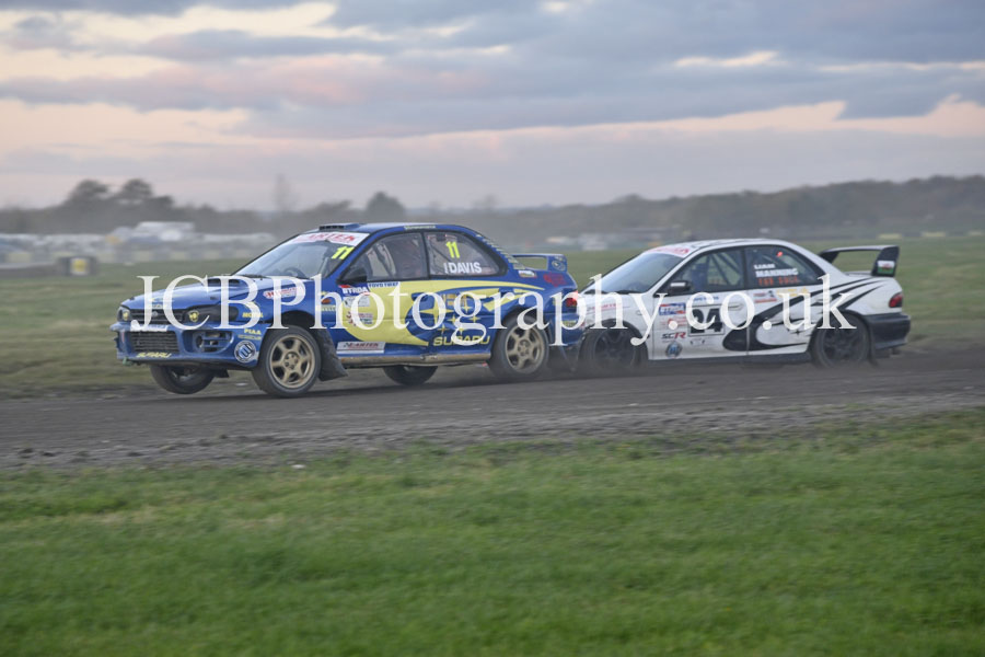Subaru Impreza driven by Paul Davis battles with a similar car of Liam Manning