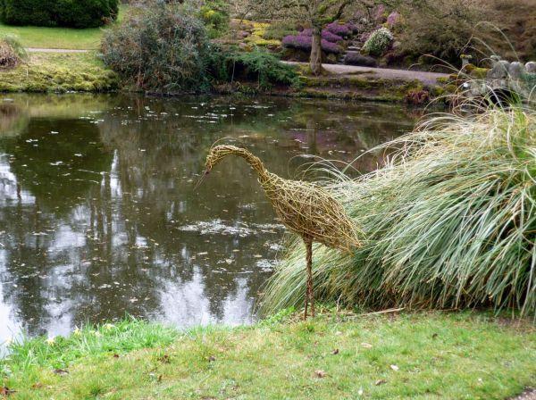 Willow Heron in ornamental garden