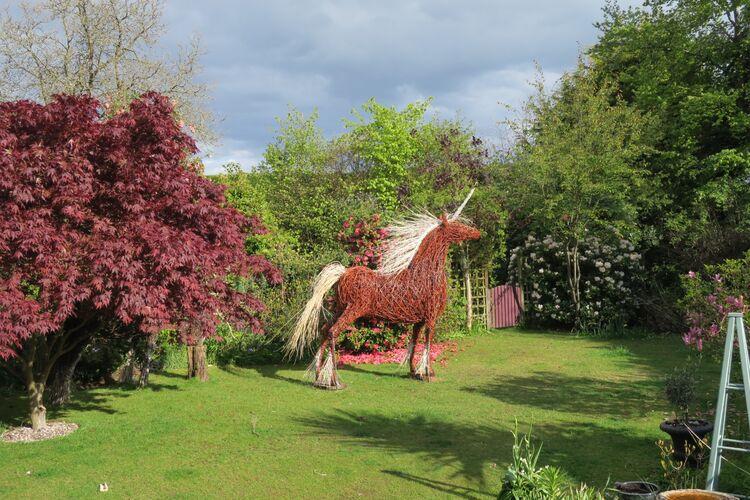Unicorn in garden - far