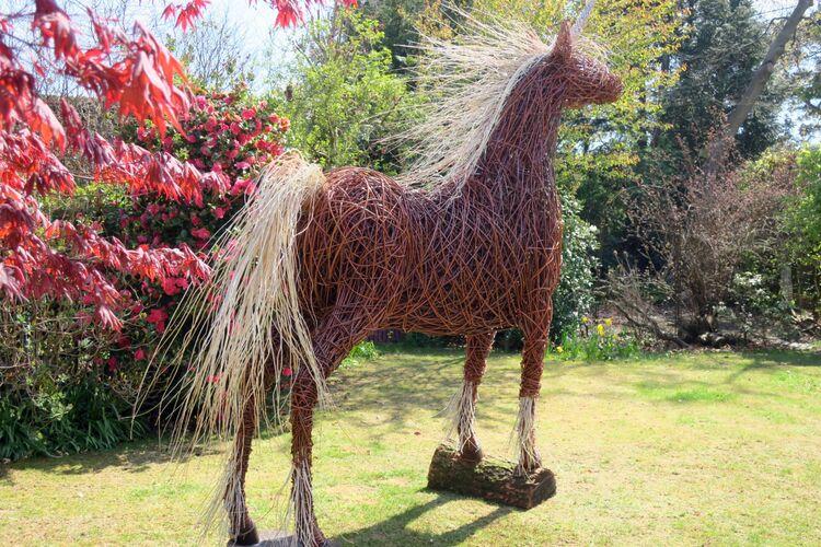 Unicorn in garden - near