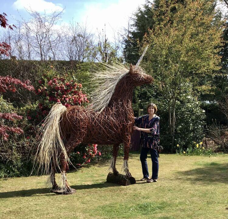 Unicorn in garden with Jane