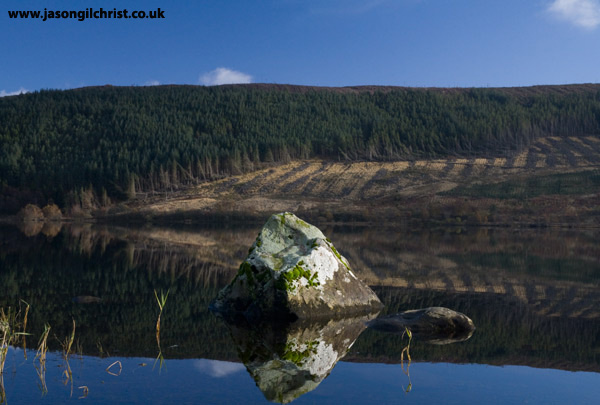Rocks and reflection on St. Mary's Loch