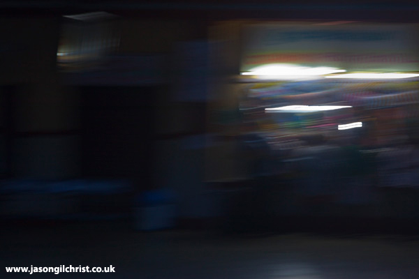 Nocturne: Kerala railway station from moving train